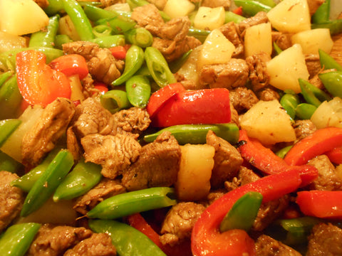 Vegetables and pork cooking in wok