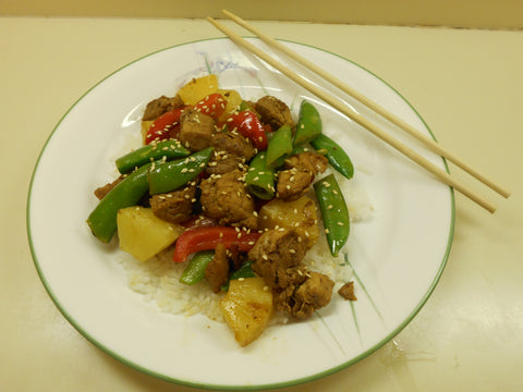 Pork, Pineapple, and Snow Pea Stir Fry plated