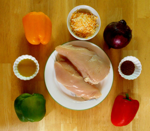 Ingredients for Chicken Fajita Bake: Chicken, Bell Peppers, Red Onion, oil, spices, and cheese