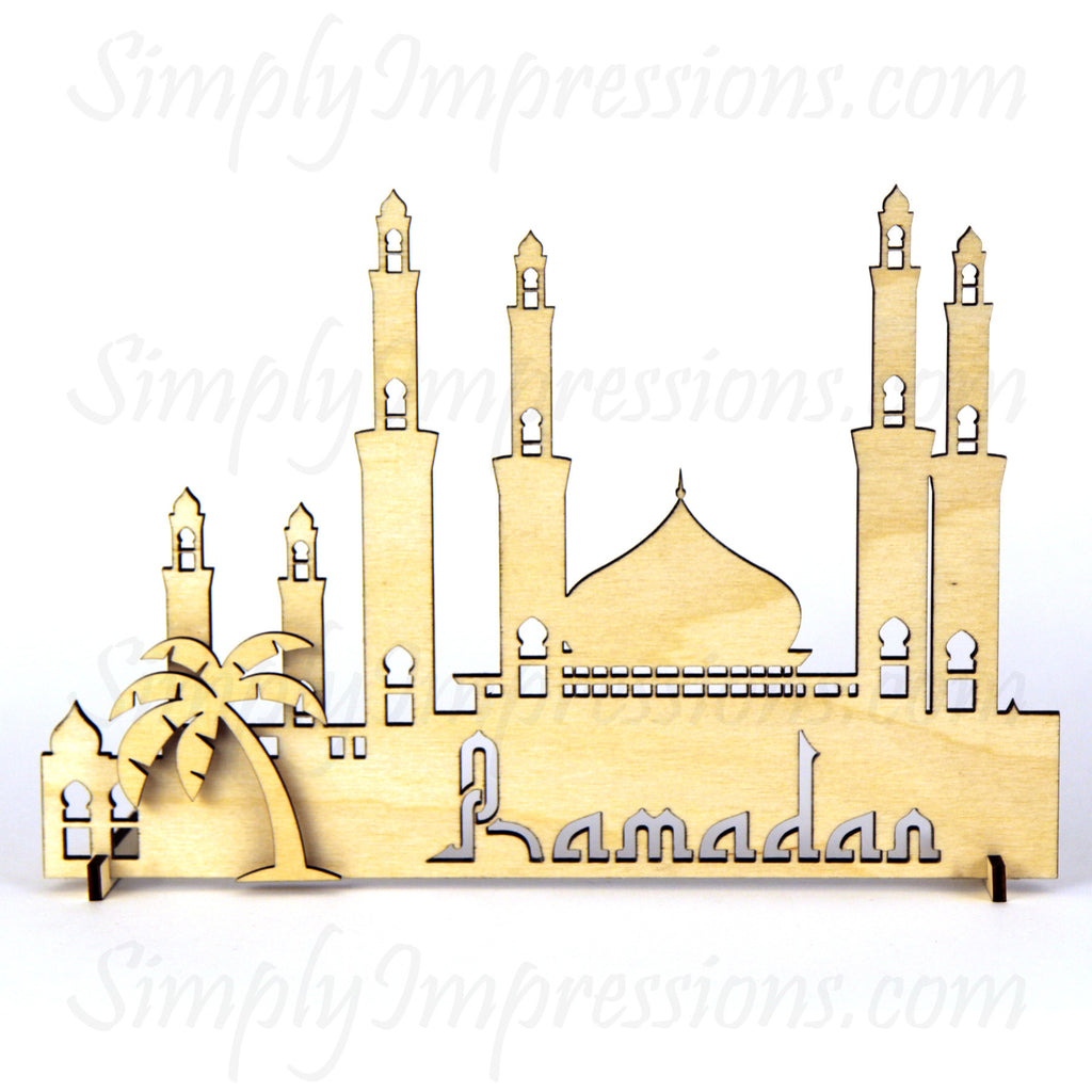 Eid Ramadan Mubarak Mosque Decoration wood cutout centerpiece engraved https://www.simplyimpressions.com/products/eid-mubarak-mosque-decoration-1 Islamic themed Free standing Masjid with palm trees and building. Intricate cut decor in 9 finishes hand painted art festive gift idea for Muslim celebration