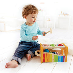 Hape Early Melodies Musical Pound and Tap Bench Toddler Playing