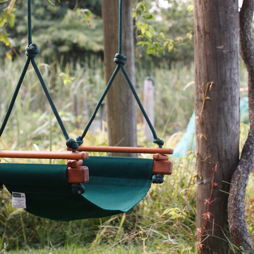 Solvej Child Swing Forest Green outside