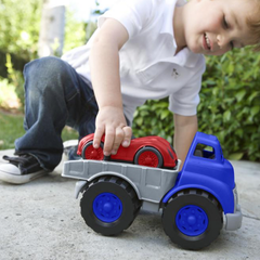 Green Toys Flatbed with Red Race Car Boy outside