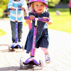 Mini Micro Scooter Deluxe Purple Girl Riding