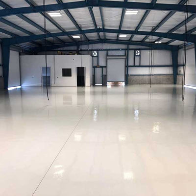 LevelGuard EP 100% solids epoxy floor in truck repair shop