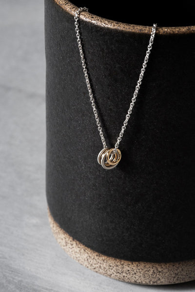 N268g.yg Famila Necklace on Sterling Silver Chain - Lifestyle Image
