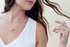 N276x.yg Black and Rose Gold Mini Inflecto Necklace - Model Image