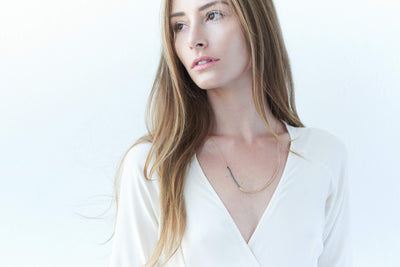 N277x.yg Black and Gold Inflecto Necklace - Model Image