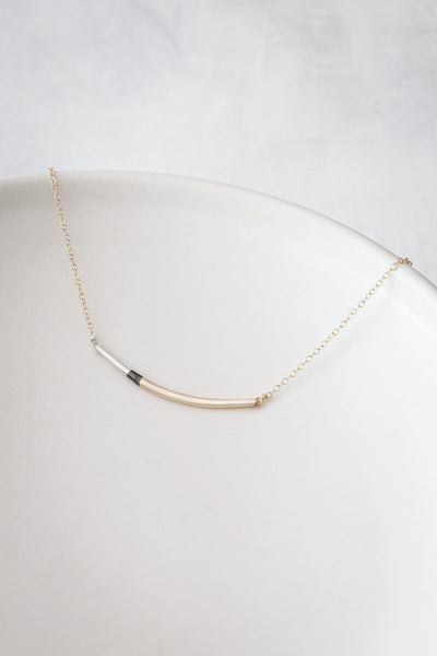 N291g.t.yg Mini Tri-Toned Arc Necklace in Yellow Gold, Silver and Black on Yellow Gold Chain - Lifestyle Image