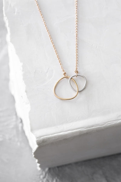 N298g.yg Yellow Gold and Silver Interlocking Necklace on Yellow Gold Chain - Lifestyle Image