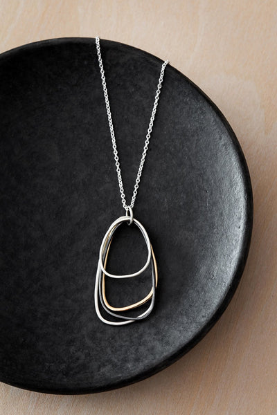 N300s.rg Silver, Rose Gold and Black Multi Triangle Necklace on Sterling Silver Chain - Lifestyle Image