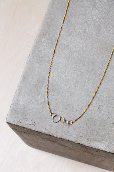 N311g.yg 5-Loop Mini Pebble Necklace in Yellow Gold and Sterling Silver