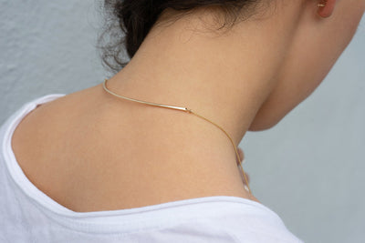 N299g.yg Long Multi Triangle Mixed Metal Necklace in Yellow Gold and Silver - Model Image