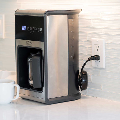 coffee pot machine on white kitchen counter top clean neat
