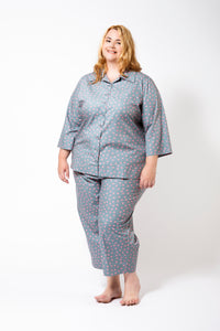 Grey Pyjamas with Pink Spots on a Plus Size Model