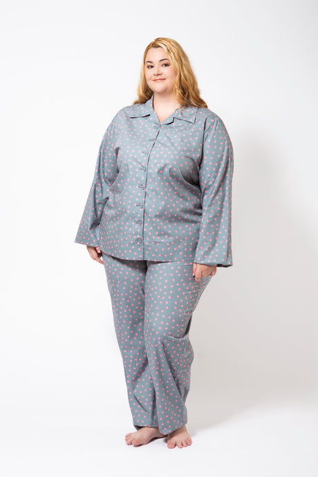 Grey Pyjamas with Pink Spots on a Plus Size Model.  Pyjamas have long sleeves and long pants.