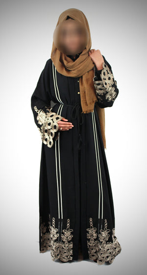Black abaya with mocha design at a park
