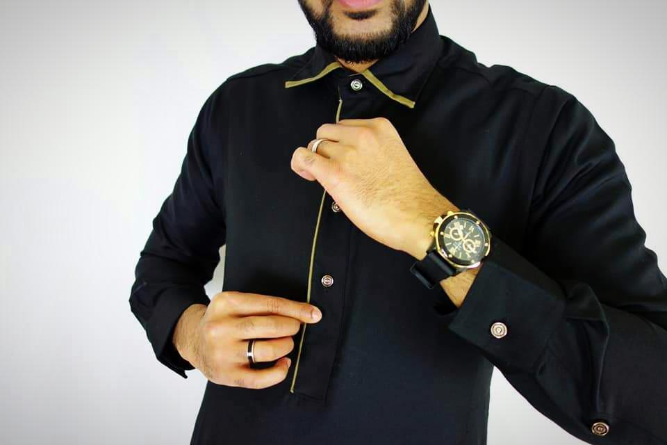 Man wearing Black Thobe with gold watch