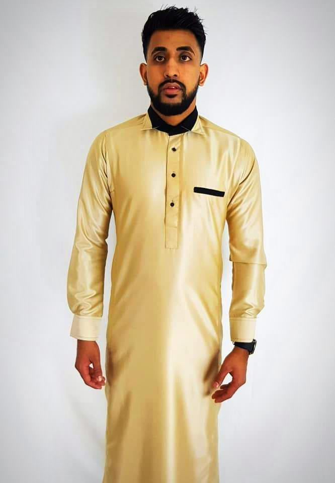 Man wearing Gold Thobes and Black watch