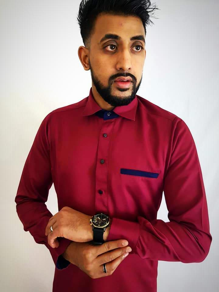 Man Wearing Maroon Thobe with watch