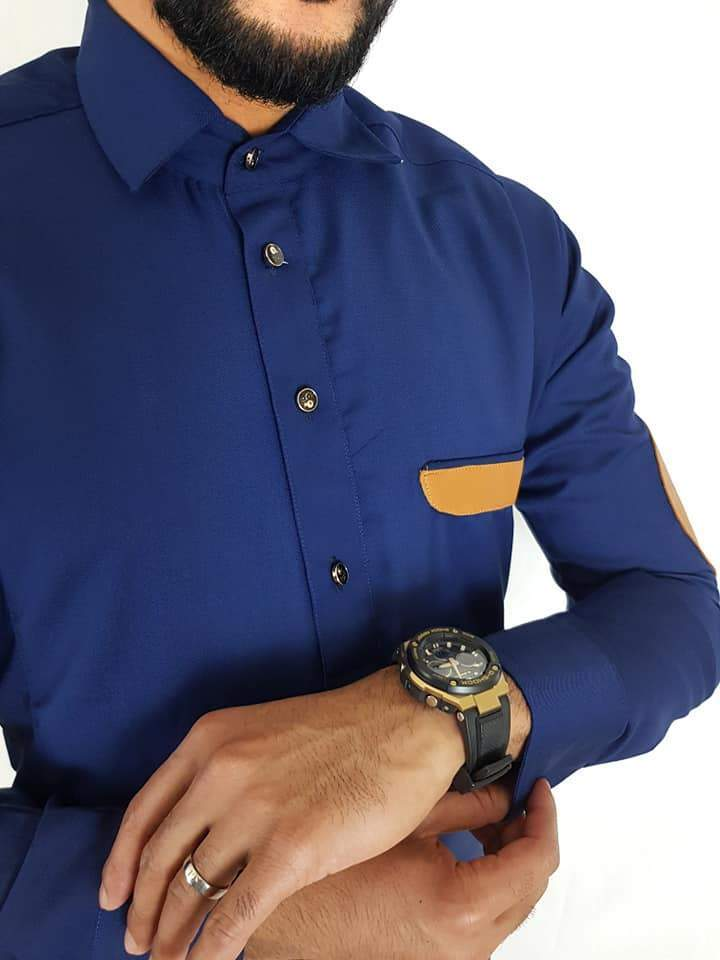 Man wearing Navy Thobe with Leather Patch