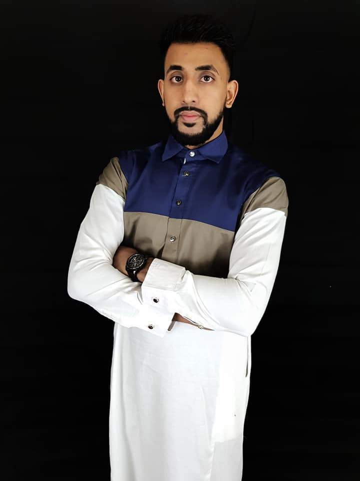Man wearing White Thobe with with Navy and Mocha Stripe