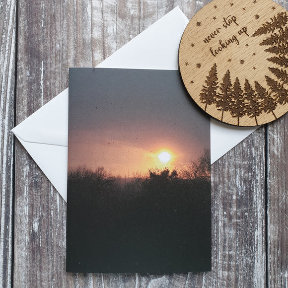 Sunset Through the Snow Photographic Greeting Card