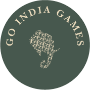 Round design element in the shape of a coin green in color layered with a small elephant and the logotype GoIndia Games in an arch on top of it
