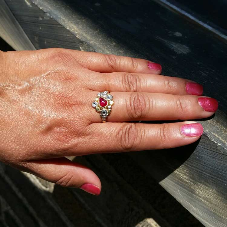 hand with Dancing Diamonds Ring with Pear Shaped Ruby