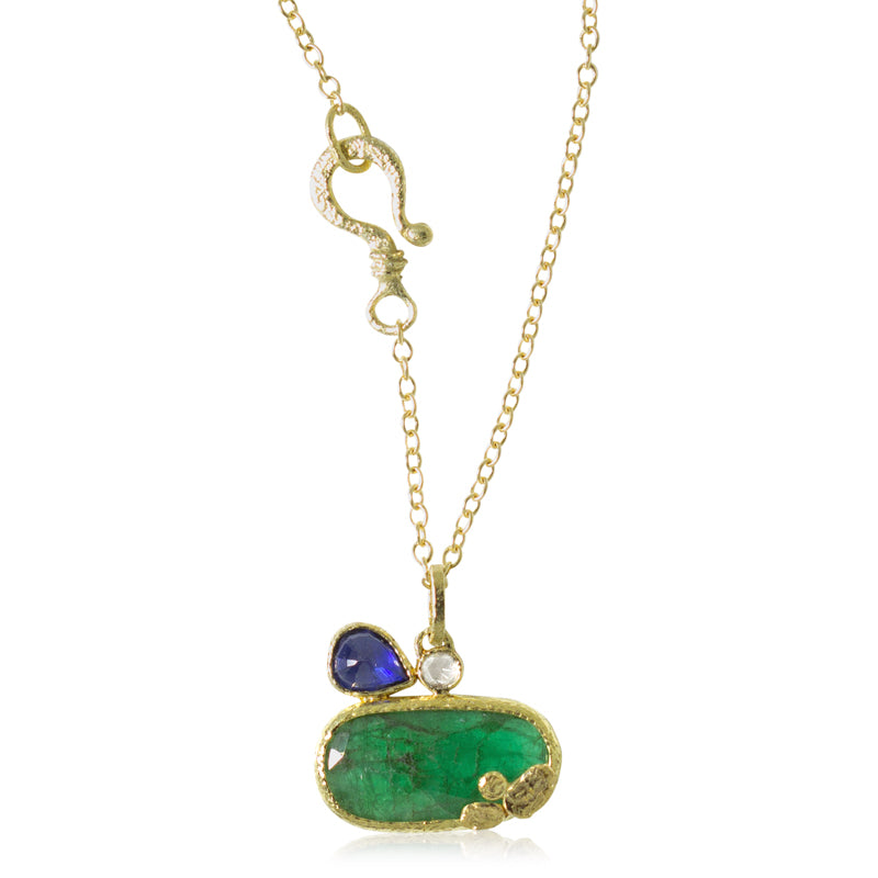 Free form emerald pendant with pear shaped sapphire