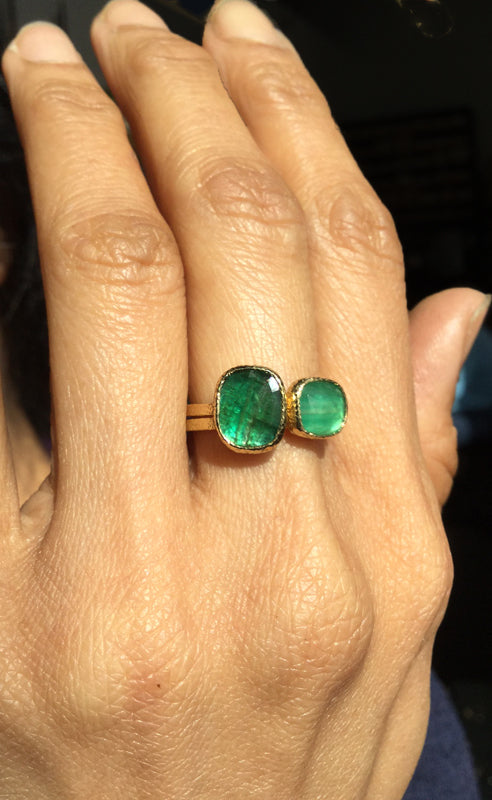 emerald stack rings on hand