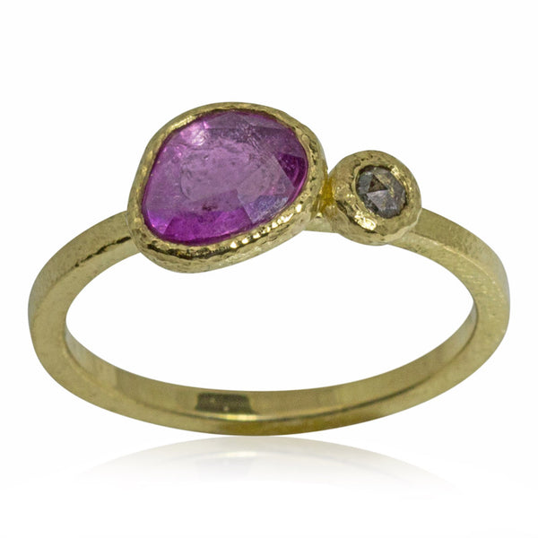 pink sapphire ring with a salt and pepper diamond