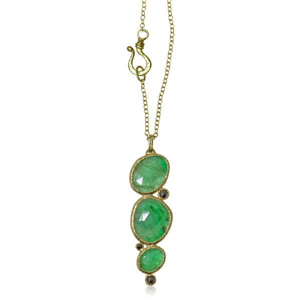 emerald and black diamond pendant