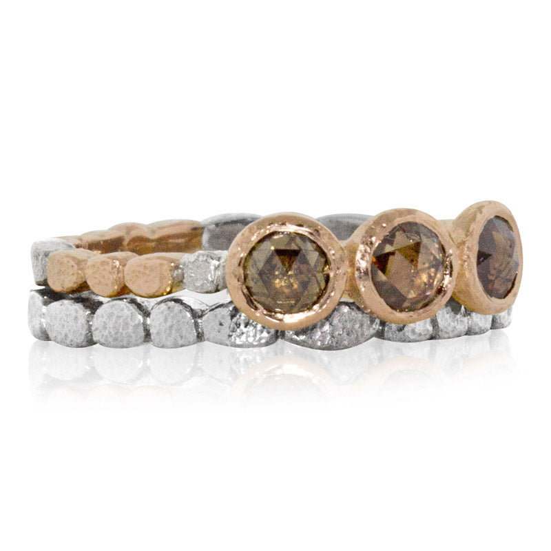skinny pebbles band stacked with cognac diamonds ring
