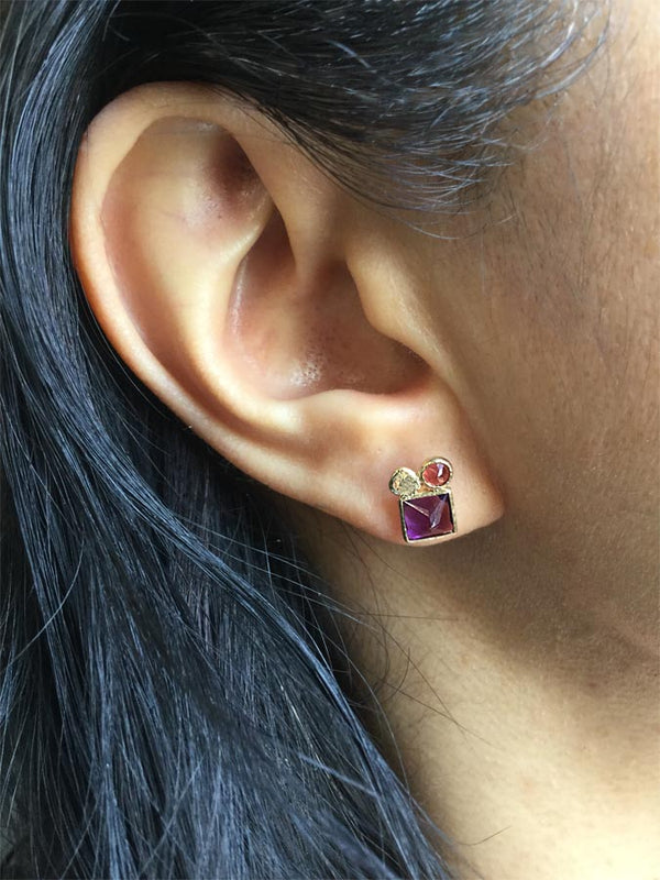 Amethyst and Garnet Stud Earring on ear