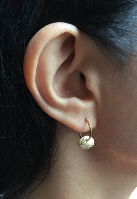 Single Pebble Hoop Earrings on ear