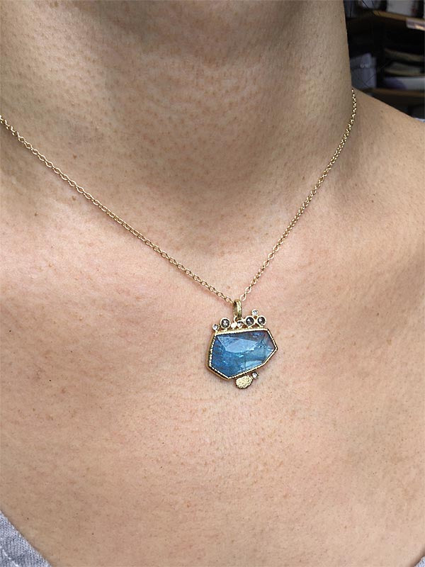 aquamarine pendant with salt and pepper diamonds on model