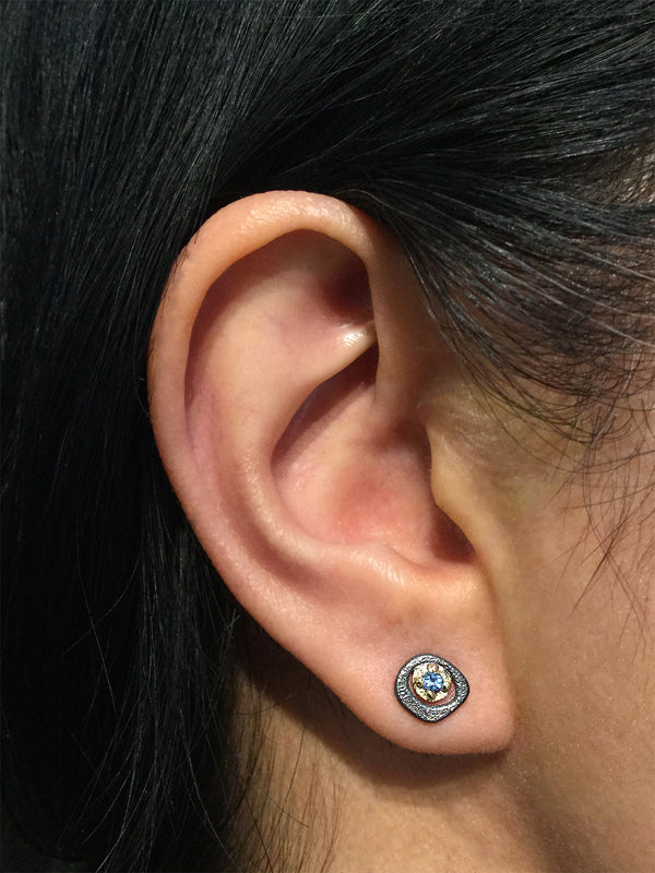 Blue Topaz stud earrings on ear