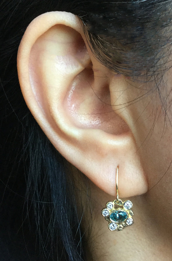Blue Zircon with white diamonds on ear
