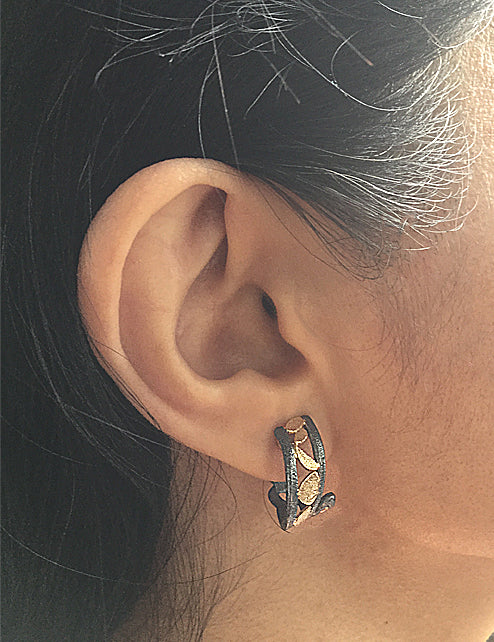 Whirlpool Earrings on ear