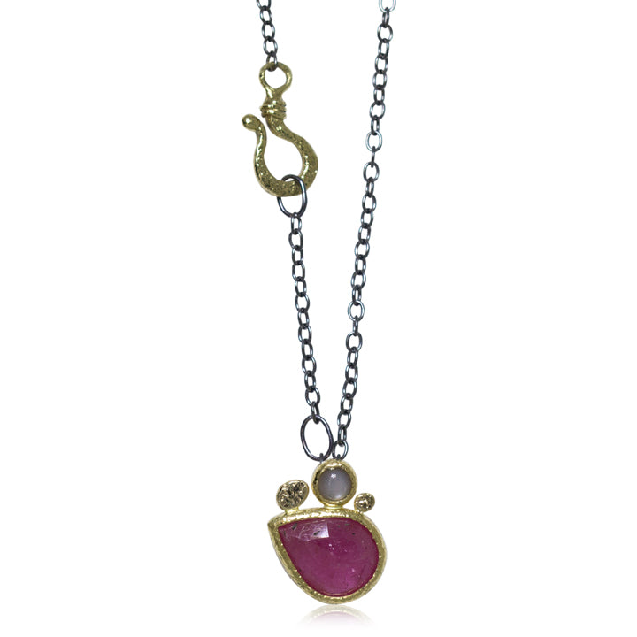 Pear shaped ruby Pendant with grey moonstone
