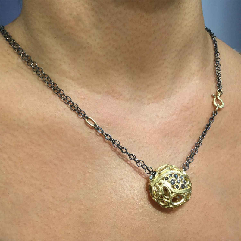 Confluence Pendant worn on neck