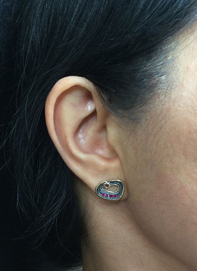 Custom Ruby Pebble Stud Earrings on ear