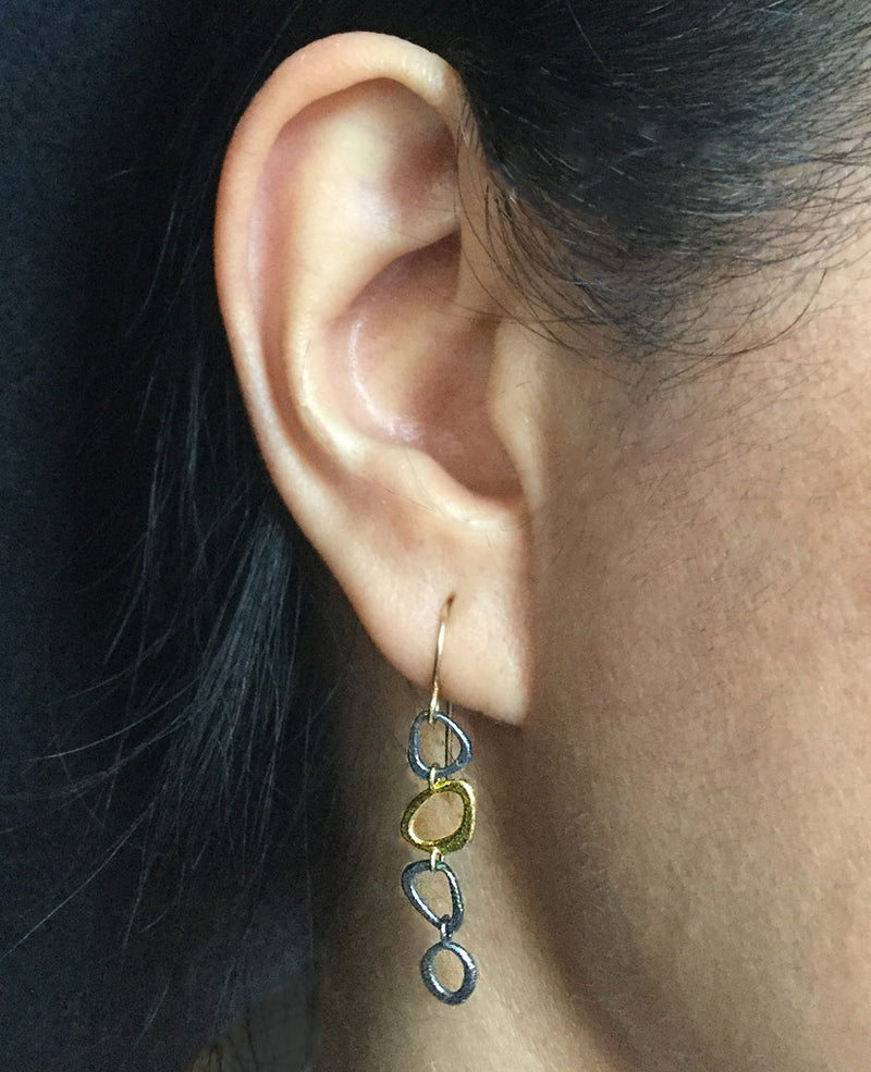 Dangle chain earrings on ear