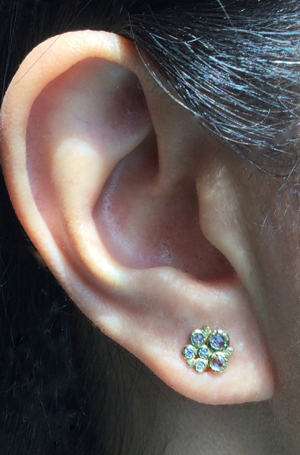 Diamond Cluster Stud Earrings in 18k yellow gold on ear