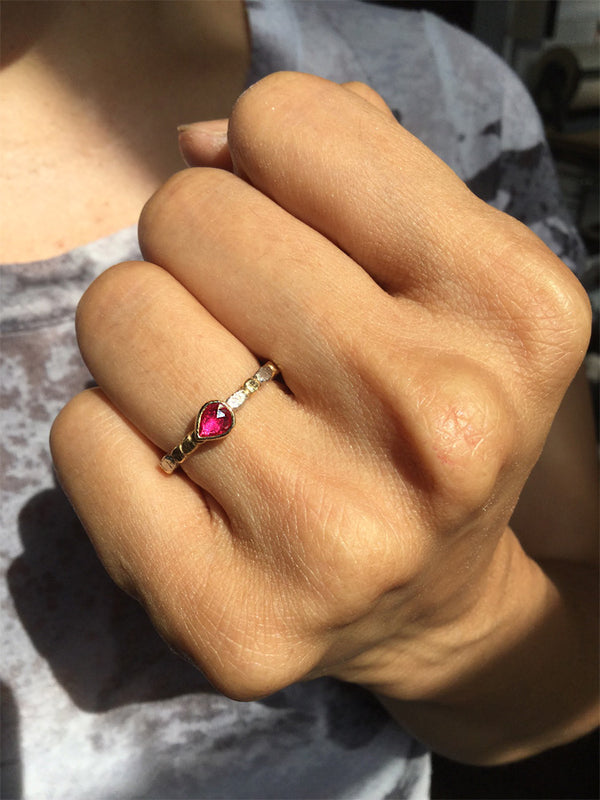 Pear shaped ruby ring on hand