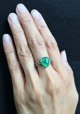 Delicate Triple Band ring with free form emerald on hand