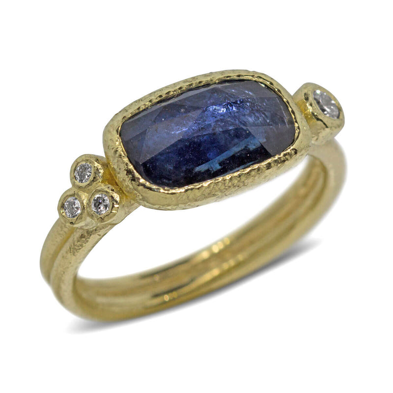 Free form sapphire ring with diamonds