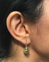 Undulation Dangle Earrings on ear