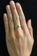 Wave Ring with hexagonal blue zircon on hand
